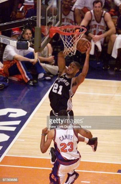 San Antonio Spurs Tim Duncan has the ball as New York Knicks' Marcus Camby looks on in Game 5 of the NBA Finals at Madison Square Garden Spurs won...