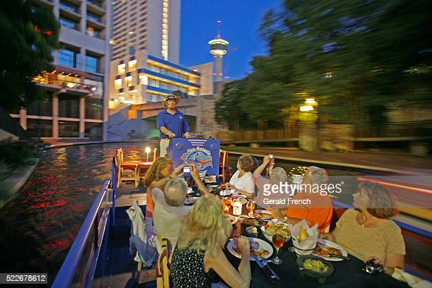 San Antonio TX dinner barge cruise with Tower the Americans in the background