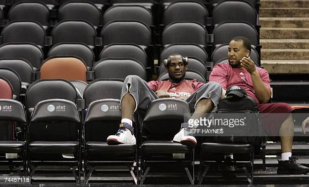 San Antonio, UNITED STATES: LeBron James of Cleveland Cavaliers sits with his road manager Randy Mims 08 June, 2007 during practice after game one of...