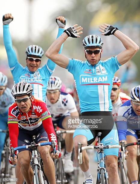San Benedetto del Tronto, ITALY: Italian Alessandro Petacchi flanked by teammate German Erik Zabel , raises his arms as he crosses the finish line of...