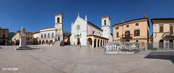 san benedetto square, church and town hall - ノルチャ ストックフォトと画像