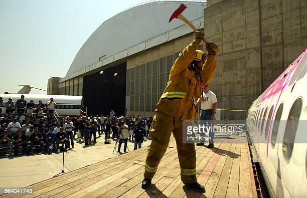 San Bernardino April 26 2004 – – – – Chuck Conner of San Bernardino County fire demonstrating use of an ax in breaking through a fuselage of plane to...