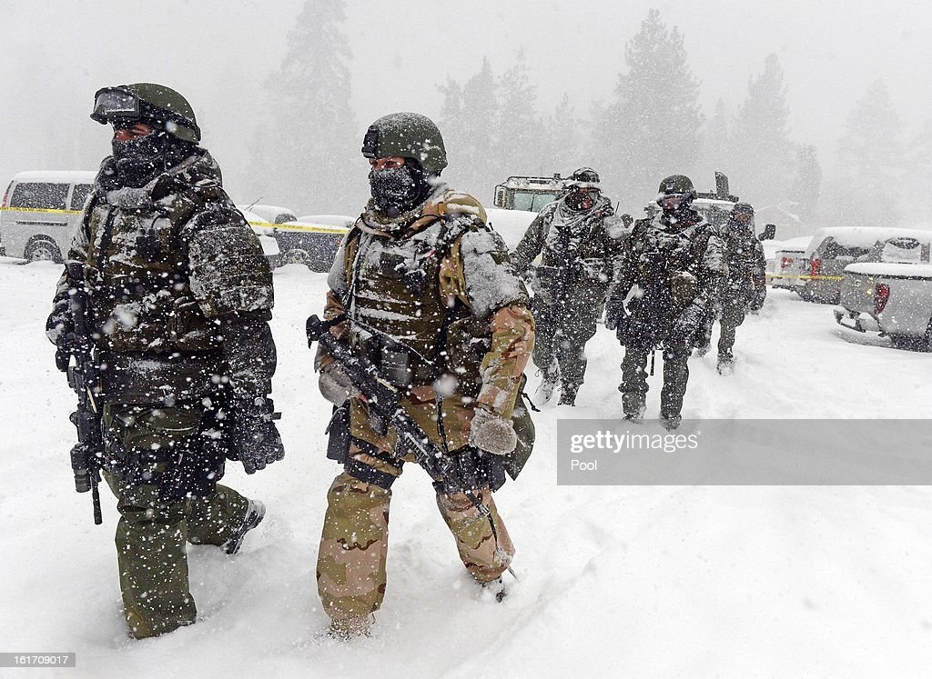 A San Bernardino County Sheriff SWAT team returns to the command post at Bear Mountain after searching for Christopher Jordan Dorner February 8, 2013 in Big Bear, California. The search has been hampered as a heavy winter storm moved into the area.