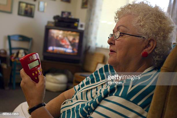 San Bernardino Dec10 2004 ––– Ernestine Young plays poker on an electronic device at her apartment in a senior citizens complex in San Bernardion...