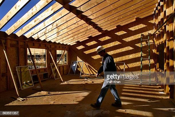 San Bernardino Dec17 2004 ––– Paul Kunze of Ellias Construction walks through the future Arts and Crafts room on the third floor of an under...