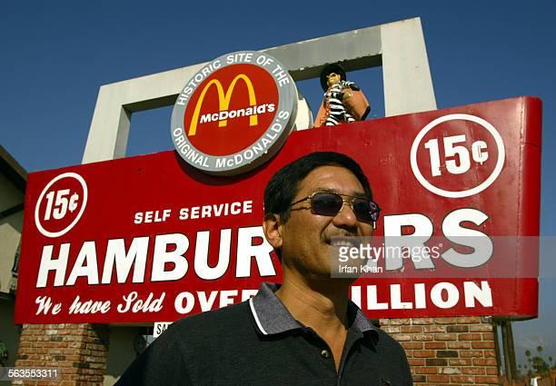 San Bernardino. Nov. 23, 2004. –––– Albert Okura , left, stands under the sign of McDonal's at historic site of original McDonald's in San Bernardino...