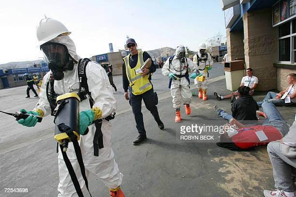 A Hazardous Materials team use biotoxin detectors as they walk past actors portraying civilians injured in a terrorist attack during Golden Guardian...