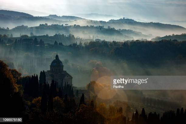 san biagio before sunset, foggy landscape, montepulciano, tuscany,italy - medieval stock pictures, royalty-free photos & images
