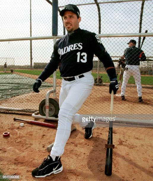 San Diego catcher Jim Leyritz stretches while waiting his turn in the batting cage behind entertainer Garth Brook during spring training 19 February...