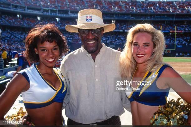 San Diego Charger Cheerleaders - Green Bay Packers CB Willie Buchanon at Jack Murphy Stadium in San Diego, California.