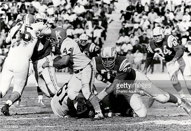 San Diego Chargers defensive tackle Ernie Ladd lunges for Houston Oilers running back Charlie Tolar during a 270 Chargers victory on December 1 at...