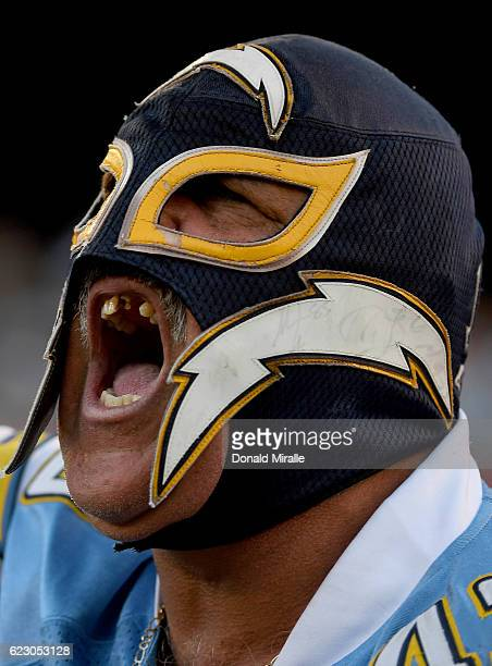 San Diego Chargers fan wearing a Lucha Libra mask yells from the stands during the Chargers' 3124 loss to the Miami Dolphins during an NFL Game at...