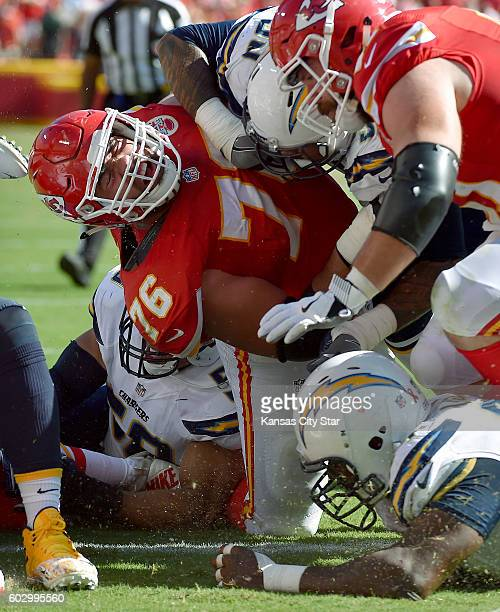 San Diego Chargers guard DJ Fluker is blocked into the pile as quarterback Alex Smith scores the winning touchdown in overtime for a 3327 win over...