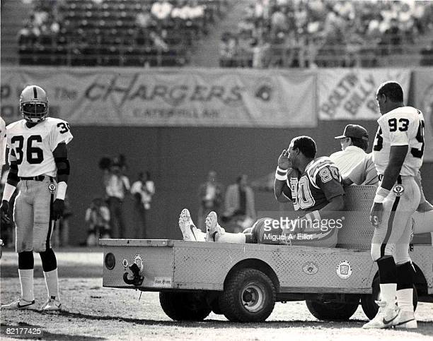 San Diego Chargers Hall of Fame tight end Kellen Winslow acknowledges teammates as he is carted off the field after suffering a knee injury during a...