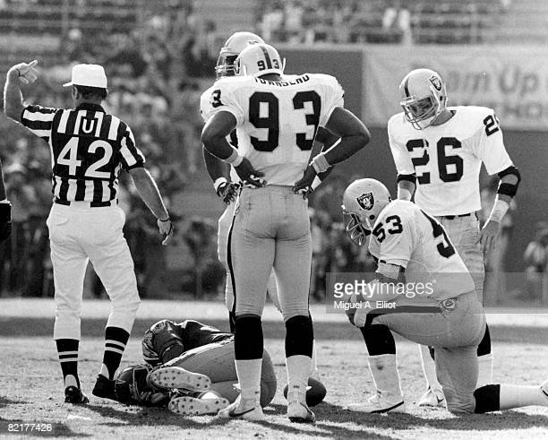 San Diego Chargers Hall of Fame tight end Kellen Winslow lies in pain on the field after suffering a knee injury during a 44 to 37 loss to the...