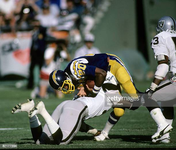 San Diego Chargers Hall of Fame tight end Kellen Winslow suffers a knee injury while being tackled by linebaker Jeff Barnes during a 44 to 37 loss to...