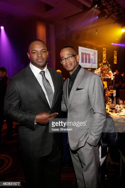 San Diego Chargers linebacker Dwight Freeney and ESPN sportscaster Stuart Scott attend the 13th annual Michael Jordan Celebrity Invitational gala at...