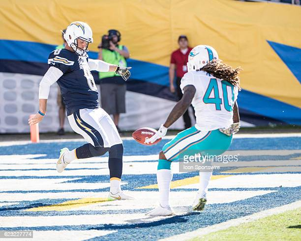 San Diego Chargers Punter Drew Kaser punts from the endzone under pressure from Miami Dolphins Cornerback Lafayette Pitts during the NFL football...