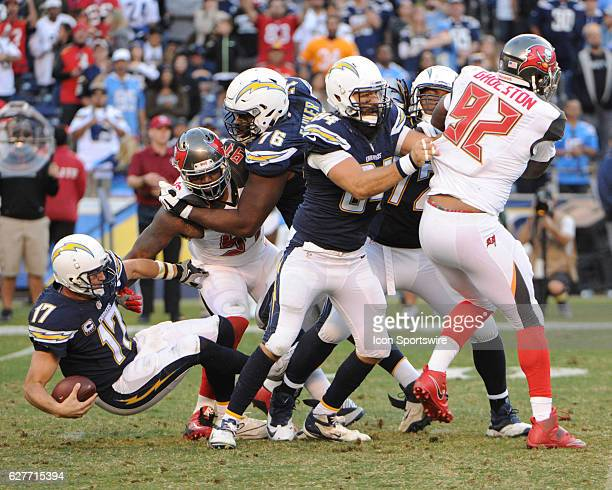 San Diego Chargers Quarterback Philip Rivers is sacked by Tampa Bay Buccaneers Defensive End Robert Ayers during the NFL football game between the...