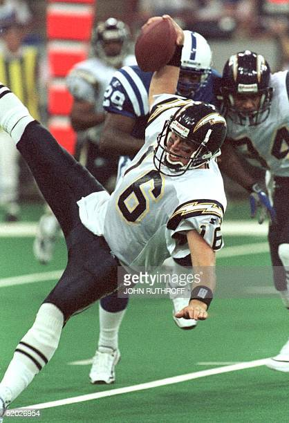 San Diego Chargers quarterback Ryan Leaf takes a spill during a preseason game with the Indianapolis Colts 22 August at the RCA Dome in Indianapolis...