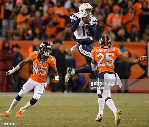 San Diego Chargers wide receiver Keenan Allen makes a catch between Denver Broncos cornerback Dominique RodgersCromartie and cornerback Chris Harris...