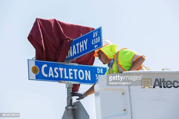 San Diego city worker installs the sign dedicating Mark Hamill Drive on July 30 2017 in San Diego California