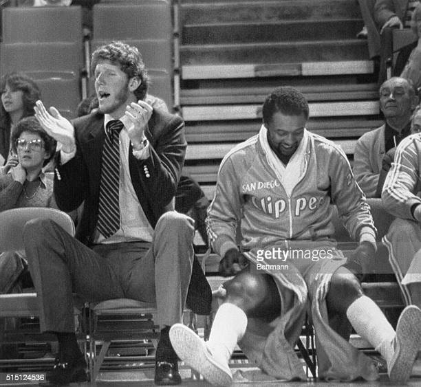 San Diego Clipper center Bill Walton sits next to Joe Bryant as he applauds his teammates from the bench during their game against the Denver Nuggets...
