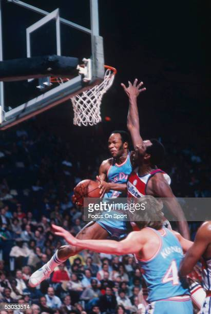 San Diego Clippers' Lloyd Free jumps and attempts to shoot but meets opposition from the Washington Bullets during a game at Capital Centre circa...