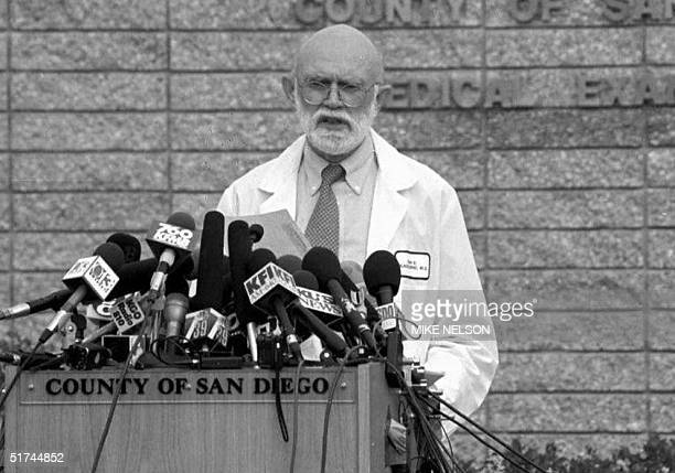 San Diego County Medical Examiner Brian Blackbourne who has been supervising the autopsies of the 39 Heaven's Gate cult suicide victims talks to the...