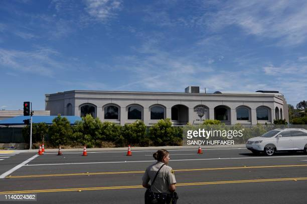 San Diego County Sheriff's deputy directs traffic in front of the Chabad of Poway Synagogue on Sunday, April 28, 2019 in Poway, California, one day...