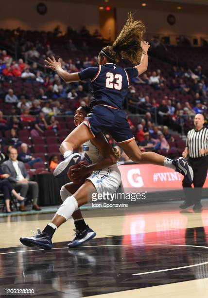 San Diego guard Karla Martnez pulled up to let Pepperdine guard Barbara Sitanggan fly by during the women's West Coast Conference game between the...