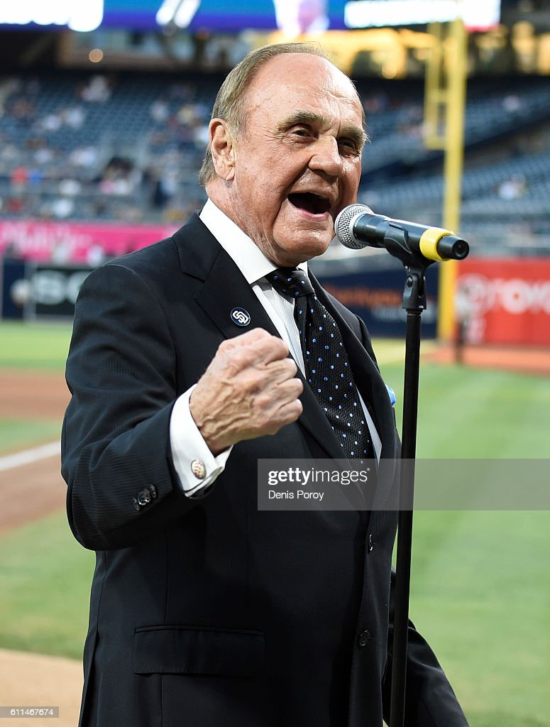 San Diego Padres announcer Dick Enberg talks to the crowd during a ceremony held before a baseball game between the San Diego Padres and the Los Angeles Dodgers at PETCO Park on September 29, 2016 in San Diego, California. The Padres held the pre-game ceremony to honor Enberg's last home game as the team's primary play-by-play man for television broadcasts.