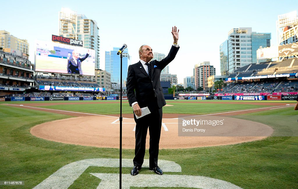 San Diego Padres announcer Dick Enberg waves to the crowd during a ceremony held before a baseball game between the San Diego Padres and the Los Angeles Dodgers at PETCO Park on September 29, 2016 in San Diego, California. The Padres held the pre-game ceremony to honor Enberg's last home game as the team's primary play-by-play man for television broadcasts.
