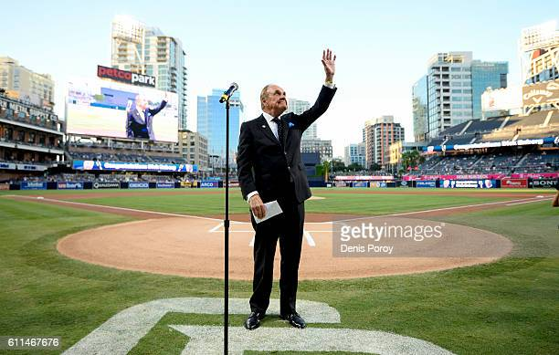 San Diego Padres announcer Dick Enberg waves to the crowd during a ceremony held before a baseball game between the San Diego Padres and the Los...