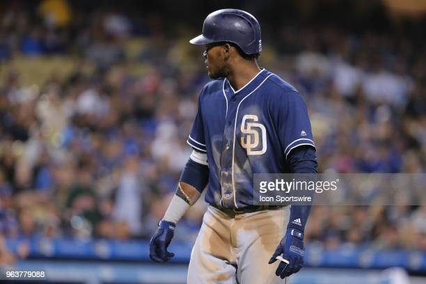 San Diego Padres center fielder Franchy Cordero looks back at the home umpire in shock after being called out on strikes while on his way to first...