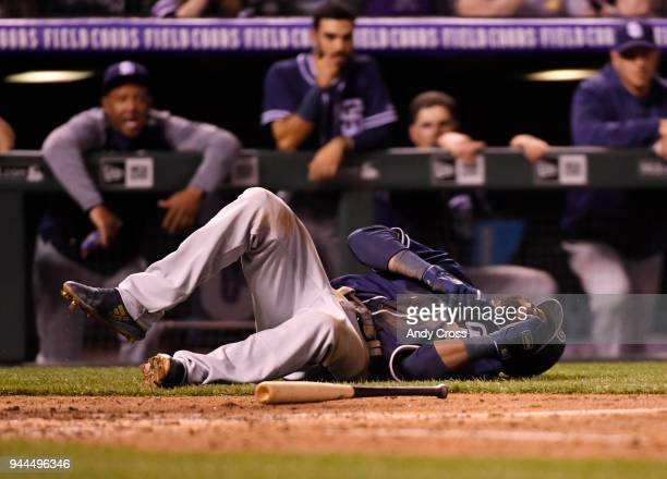 San Diego Padres center fielder Manuel Margot hits the ground after being hit with a pitch from Colorado Rockies relief pitcher Scott Oberg in the...