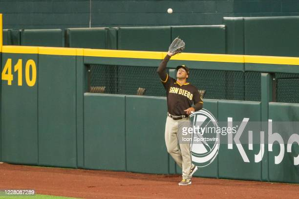 San Diego Padres center fielder Trent Grisham makes a catch on the warning track during the MLB game between the San Diego Padres and Texas Rangers...