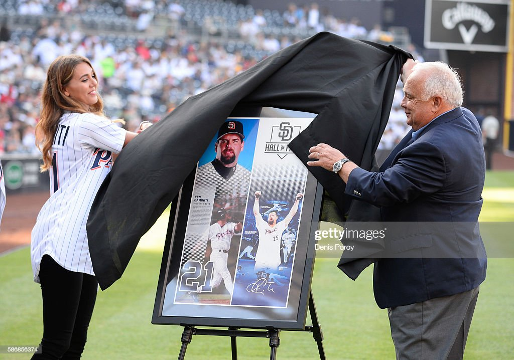 San Diego Padres executive chairman Ron Fowler and Kendall Caminiti unveil a poster of former Padre Ken Caminiti as he is inducted into the San Diego Padres Hall of Fame before a baseball game between San Diego Padres and the Philadelphia Phillies at PETCO Park on August 6, 2016 in San Diego, California.