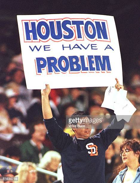 San Diego Padres' fan holds up a sign with a popular line from the film 'Apollo 13' during the 03 October game against the Houston Astros in San...
