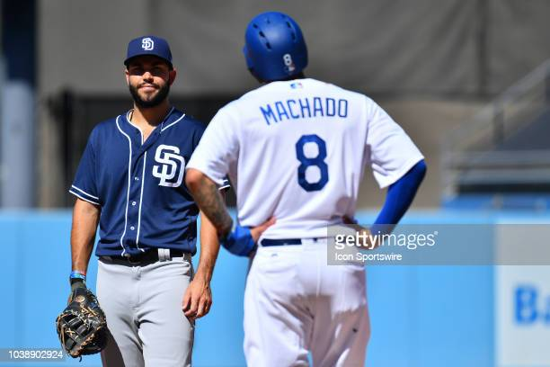 San Diego Padres first baseman Eric Hosmer jokes with Los Angeles Dodgers shortstop Manny Machado during a MLB game between the San Diego Padres and...