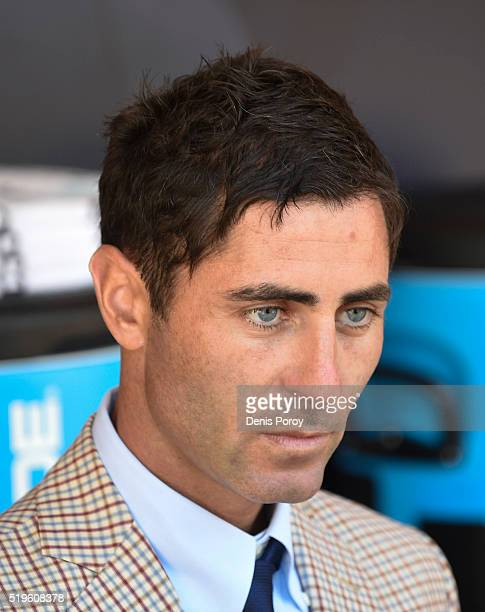 San Diego Padres general manager AJ Preller answers questions in the dugout during batting practice before a baseball game against the Los Angeles...
