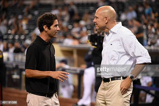 San Diego Padres general manager AJ Preller left talks with Padres president Mike Dee before a baseball game against the Milwaukee Brewers at Petco...