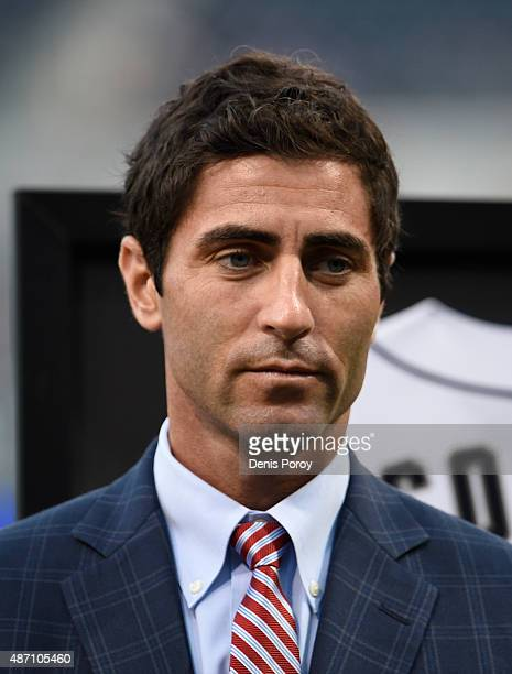San Diego Padres general manager AJ Preller looks on during a ceremony before a baseball game against the Texas Rangers at Petco Park September 2015...