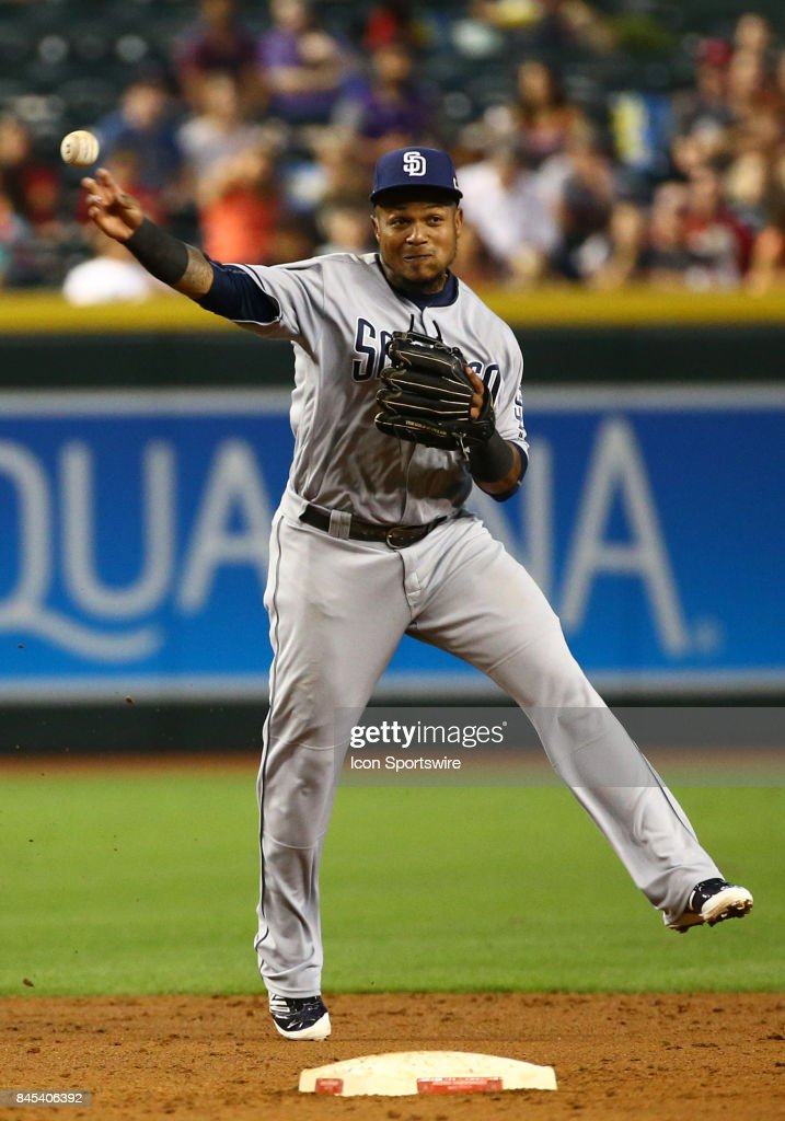 San Diego Padres Infield Erick Aybar (8) throws to first base for the out during the MLB baseball game between the San Diego Padres and the Arizona Diamondbacks on September 10, 2017 at Chase Field in Phoenix, AZ