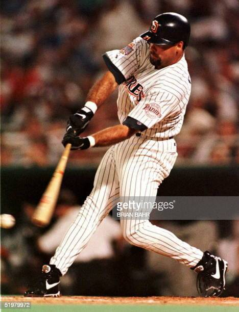 San Diego Padres' Ken Caminiti hits a solo home run off of the Texas Rangers Roger Pavlik to score the final run in the National League's 60 shutout...