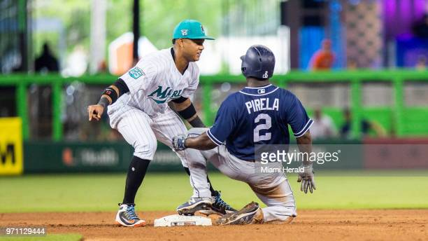 San Diego Padres outfielder Jose Pirela is tagged out by Marlins second baseman Starlin Castro during the sixth inning on Sunday June 10 2018 at...