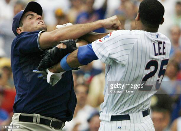 San Diego Padres pitcher Chris Young left fights with Chicago Cubs' Derrek Lee after Lee was hit in the wrist by a pitch in the bottom of the fourth...