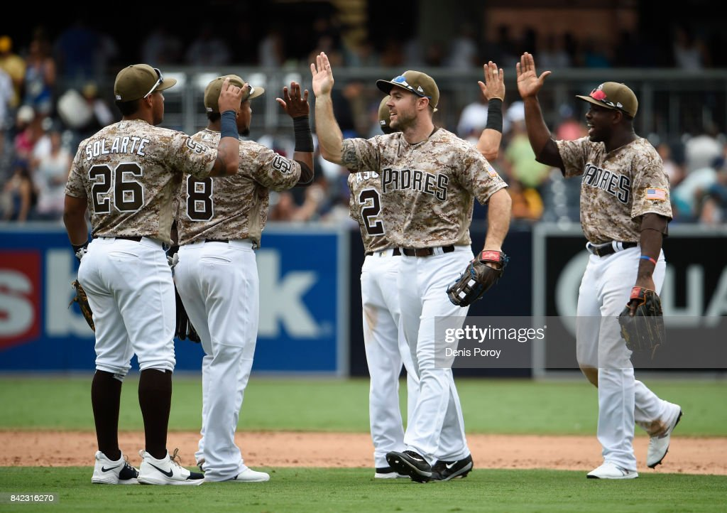 San Diego Padres players celebrate after beating the Los Angeles Dodgers 6-4 in a baseball game at PETCO Park on September 3, 2017 in San Diego, California.