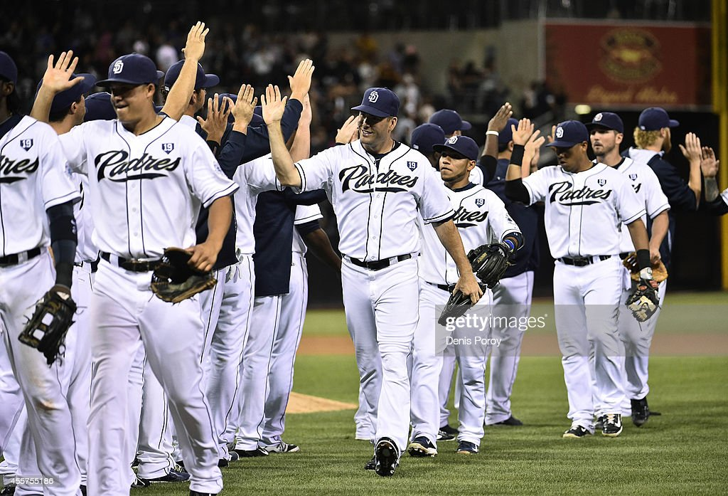 San Diego Padres players celebrate after the Padres beat the San Francisco Giants 5-0 in a baseball game at Petco Park September, 19, 2014 in San Diego, California.
