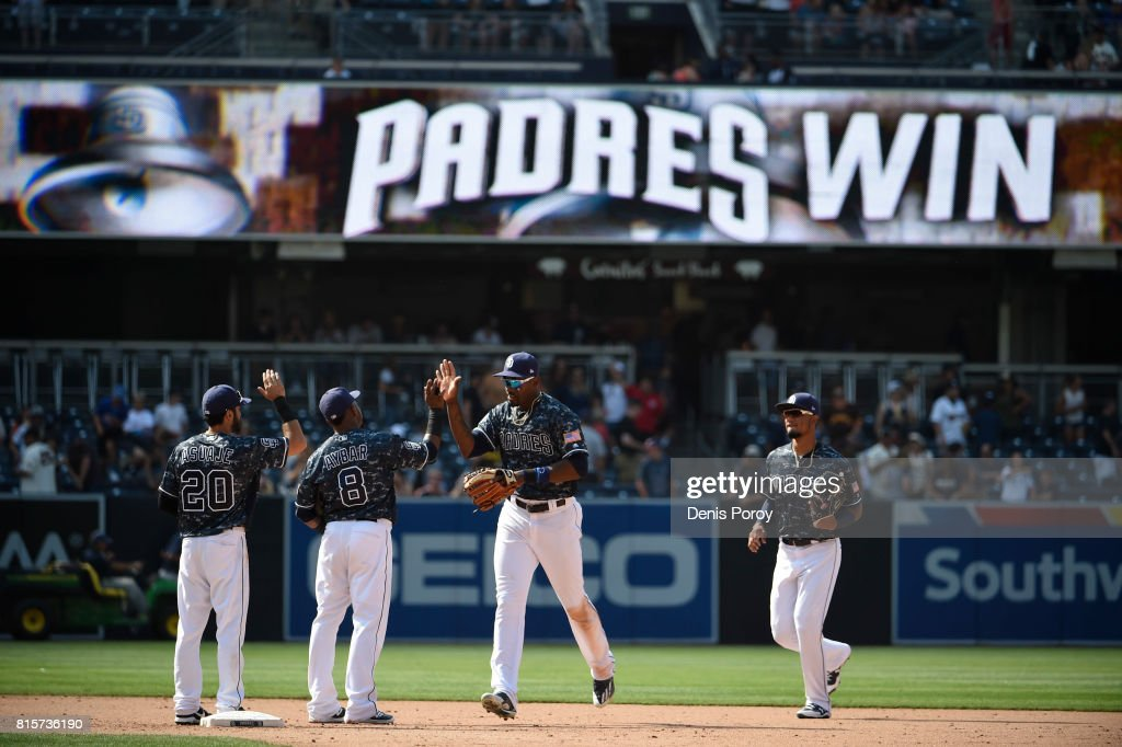 San Diego Padres players high five after beating the San Francisco Giants 7-1 in a baseball game at PETCO Park on July 16, 2017 in San Diego, California.